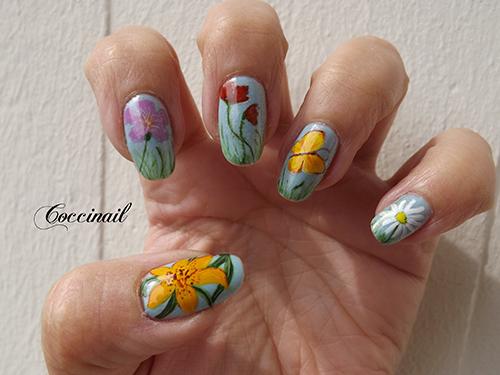Nail art papillon et fleurs